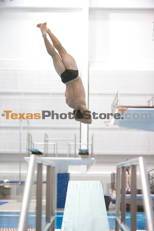 Sean O'Brien competes in the 1 meter dive...UT Men's Swimming Orange v White Meet
