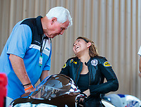 Jul 19, 2019; Morrison, CO, USA; NHRA pro stock motorcycle rider Jianna Salinas with track owner John Bandimere during qualifying for the Mile High Nationals at Bandimere Speedway. Mandatory Credit: Mark J. Rebilas-USA TODAY Sports