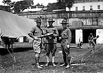 Petersburg VA:  Officer and two Sargents going over the manual at boot camp,  80th Division encampment - 1918