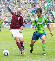 Colorado Rapids forward Conor Casey keeps the ball away from Seattle Sounders FC defender Patrick Ianni at CenturyLink Field in Seattle Saturday July 16, 2011. The Sounders won the game 4-3.