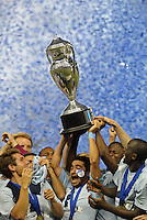 Paulo Nagamura (6) midfield Sporting KC holds aloft the trophy..Sporting Kansas City defeated Seattle Sounders on penalty kicks, after a 1-1 tied game to win the Lamar Hunt Open Cup at LIVESTRONG Sporting Park, Kansas City, Kansas..