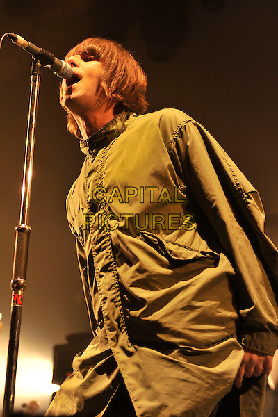 LIAM GALLAGHER of BEADY EYE .Beady Eye perform live at The Troxy, London, England, UK, March 9th 2011..half length band group new music gig on stage concert microphone singing green jacket parka parker coat hands in pockets .CAP/MAR.© Martin Harris/Capital Pictures.