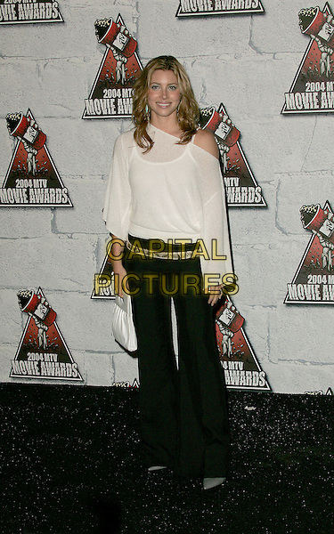 JESSICA BIEL.Attends the 2004 Mtv Movie Awards held at The Sony Picture Studios in Culver City, California  .June 6, 2004.full length, full-length, white see through, see thru off the shoulder top, black trousers.www.capitalpictures.com.sales@capitalpictures.com.©Capital Pictures