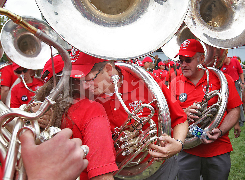 Fired OSU Marching Band Director received condolences from fellow members of the Alumni Band before marching into at Ohio Stadium on Septmber 13, 2014.  (Chris Russell/Dispatch Photo)