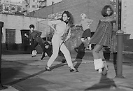 New York City, NY, 1966-1967. A community of transvestites, living around 66th Street and Broadway where they use to work at night. During the day instead they design clothes, play with dolls, and organize little fashion shows on the rooftops.