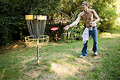 David H., of Chapel Hill, prefers to play the UNC frisbee golf course with a beer in tow.