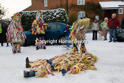 Otterbourne Mummers Hampshire UK December 2010. Death and Revival The Quack Doctor works a magic potion.