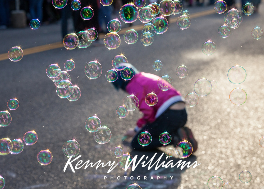 Little Girl Playing with Chalk, Surrounded by Bubbles, Arts A Glow Festival, Burien, WA, USA.