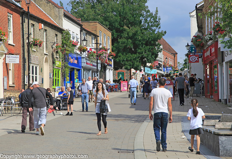 Shoppers in pedestrianised street, King Street, town centre, Thetford, Norfolk, England, UK