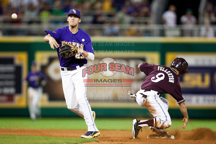 LSU Tigers second baseman JaCoby Jones #23 throws the ball to first to complete a double-play as Mississippi State baserunner Tyler Fullerton #9 slides into second base during the NCAA baseball game on March 17, 2012 at Alex Box Stadium in Baton Rouge, Louisiana. The 10th-ranked LSU Tigers beat #21 Mississippi State, 4-3. (Andrew Woolley / Four Seam Images)