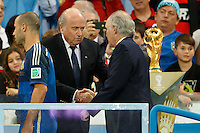Argentina manager Alejandro Sabella walks past the World Cup trophy and shakes hands with FIFA president Sepp Blatter