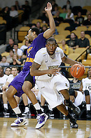 January 19, 2011: Central Florida forward Keith Clanton (33) is fouled by East Carolina forward Darrius Morrow (1) as he drives the baseline  during second half Conference USA NCAA basketball game action between the East Carolina Pirates and the Central Florida Knights. East Carolina defeated Central Florida 74-62 at the UCF Arena Orlando, Fl..