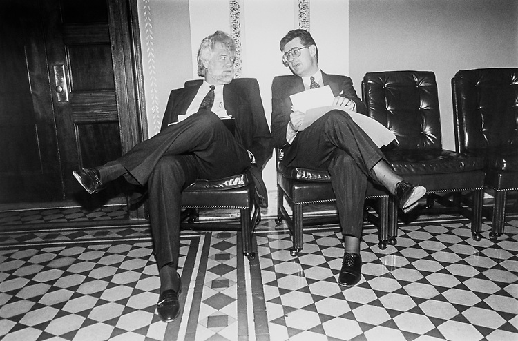 Rep. Fred Grandy, R-Iowa, and Rep. Jim McDermott, D-Wash, sitting outside of the House Admin Committee room before they discuss the Ethics budget on Feb. 23, 1993. (Photo by Maureen Keating/CQ Roll Call)