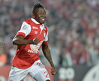 BOGOTÁ-COLOMBIA-03-04-2014.  Jefferson Cuero jugador de Independiente Santa Fe de Colombia celebra un gol anotado a Atlético Mineiro de Brasil durante partido de vuelta por la primera fase, llave G4, de la Copa Bridgestone Libertadores en el estadio Nemesio Camacho El Campin, de la ciudad de Bogota. / Jefferson Cuero player of Independiente Santa Fe of Colombia celebrates a goal scored to Atletico Mineiro of Brazil in a match for the second leg for the first phase, G4 key, of the Copa Bridgestone Libertadores in the Nemesio Camacho El Campin in Bogota city.  Photo: VizzorImage/ Gabriel Aponte /Staff