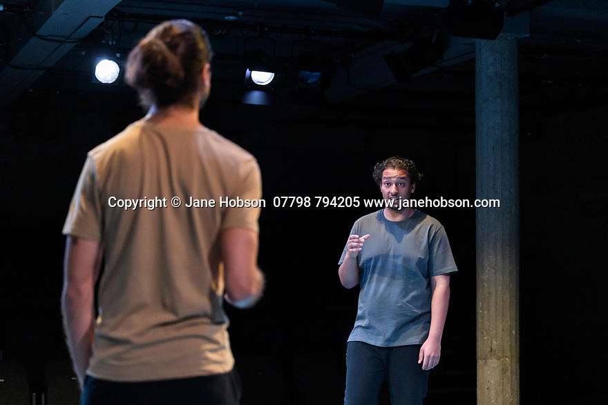 """""""The Arrival"""", written and directed by Bijan Sheibani, opems at the Bush Theatre. Set and costume design is by Samal Black, lighting design by Oliver Fenwick, movement direction by Aline David. The Picture shows: Scott Karim (Tom), Irfan Shamji (Samad)."""