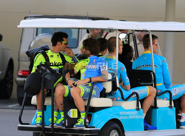 Riders arrive by golf cart from their adjacent hotel before the start of Stage 1, the Dubai Silicon Oasis Stage, of the 2016 Dubai Tour starting at the Dubai International Marine Club and running 175km to Fujairah, Mina Seyahi, Dubai, United Arab Emirates. 3rd February 2016.<br /> Picture: Eoin Clarke | Newsfile<br /> <br /> <br /> All photos usage must carry mandatory copyright credit (&copy; Newsfile | Eoin Clarke)