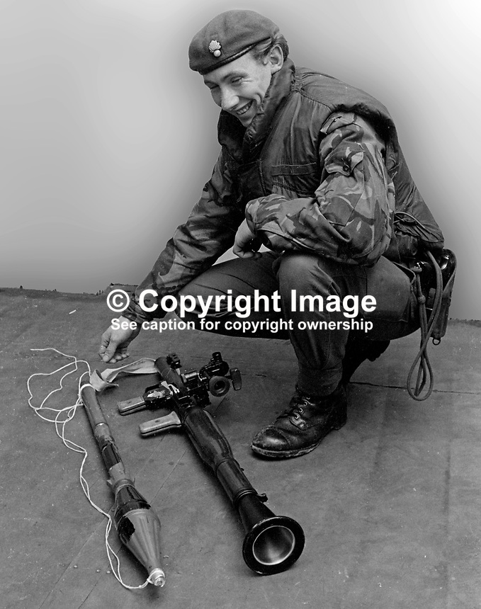Soldier displays a Russian Bazooka Type Rocket Launcher which had been  used for several days by the Provisional IRA in a concerted rocket attack on British Army and RUC installations in Londonderry, N Ireland, in November 1972. It was believed to have also been used against police in Belleek where one RUC constable died and in Lurgan, Co Armagh injuring seven soldiers.197211280755<br /> <br /> Copyright Image from Victor Patterson, 54 Dorchester Park, Belfast, UK, BT9 6RJ<br /> <br /> t1: +44 28 9066 1296 (from Rep of Ireland 048 9066 1296)<br /> t2: +44 28 9002 2446 (from Rep of Ireland 048 9002 2446)<br /> m: +44 7802 353836<br /> <br /> e1: victorpatterson@me.com<br /> e2: victorpatterson@gmail.com<br /> <br /> The use of my copyright images is subject to my Terms &amp; Conditions.<br /> <br /> It is IMPORTANT that you familiarise yourself with them. They are available on my website at www.victorpatterson.com.<br /> <br /> None of my copyright images may be used on a website unless they are visibly watermarked, i.e. &copy; Victor Patterson within the body of the visible image. Metadata denoting my copyright must NOT be deleted. <br /> <br /> Web use is extra at currently recommended NUJ rates.