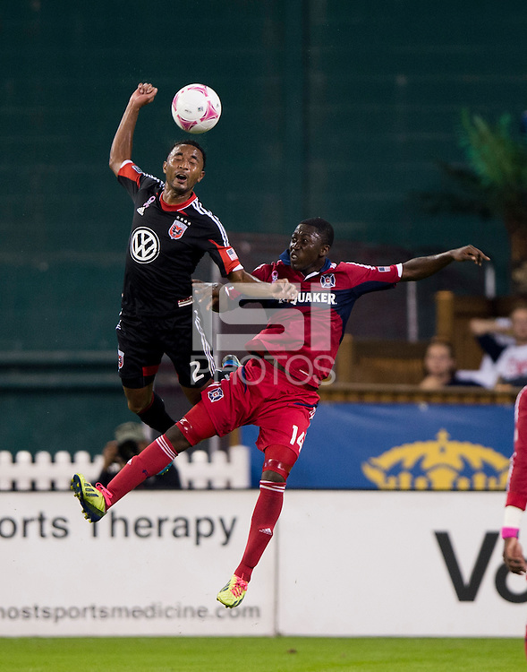 Patrick Nyarko (14) of the Chicago Fire goes up for a header with James Riley (2) of D.C. United during a Major League Soccer game at RFK Stadium in Washington, DC.  The Chicago Fire defeated D.C. United, 3-0.