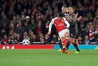 Alexis Sanchez of Arsenal is fouled by Rafinha of Bayern Munich during the UEFA Champions League round of 16 match between Arsenal and Bayern Munich at the Emirates Stadium, London, England on 7 March 2017. Photo by Alan  Stanford / PRiME Media Images.