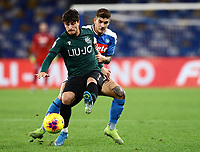 1st December 2019; Stadio San Paolo, Naples, Campania, Italy; Serie A Football, Napoli versus Bologna; Riccardo Orsolini of Bologna clears the ball under pressure - Editorial Use