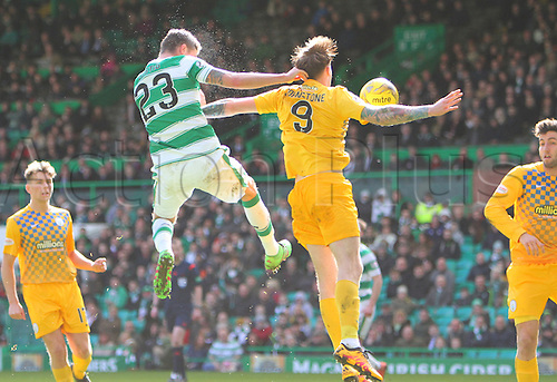 06.03.2016. Celtic Park, Glasgow, Scotland. Scottish Cup. Celtic versus Morton. Mikael Lustig beats Denny Johnstone in the air