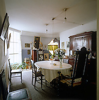 The evocative clutter in the dining room brings the past to life