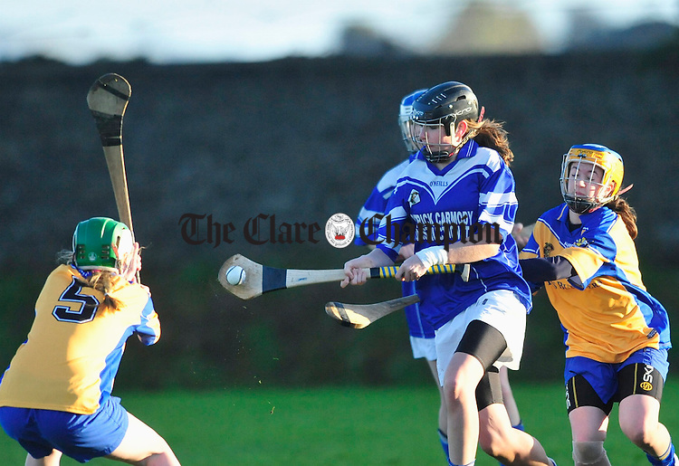 Kimaley's Lorna Higgins under pressure from the Sixmilebridge defence. Photograph by Declan Monaghan