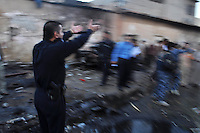 KIRKUK, IRAQ: A policeman shouts at people in the street at the scene of a triple car bomb...At 6 am, three car bombs detonated in the peaceful Kurdish neighborhood of Imam Kasimin Kirkuk.  There were 17 casualties.  Kirkuk is Iraq's most ethnically mixed city and is one month away from a volatile census that will determine the future of the city...Picture/ Ari Mohammad/Universal News And Sport (Europe) 6 November 2010.