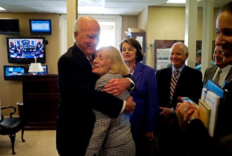 WASHINGTON, DC - August 06: Senate Judiciary Chairman Patrick J. Leahy, D-Vt., gets a hug from wife Marcelle before a news conference following the vote on Sonia Sotomayor's nomination to be a U.S. Supreme Court justice. Looking on are Sen. Dianne Feinstein, D-Calif., Sen. Benjamin L. Cardin, D-Md., and Sen. Richard J. Durbin, D-Ill. A little more than three months after Justice David H. Souter announced his intention to retire, the Senate on Thursday confirmed Sonia Sotomayor to become the Supreme Court's first Hispanic justice. The vote was 68-31. (Photo by Scott J. Ferrell/Congressional Quarterly)