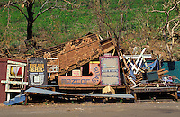 Piled debris in Hanapepe ten days after Hurricane Iniki