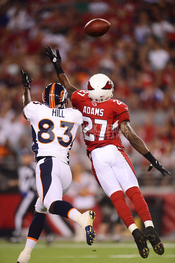 Aug. 30, 2012; Glendale, AZ, USA; Arizona Cardinals cornerback (27) Michael Adams breaks up a pass intended for Denver Broncos wide receiver (83) Jason Hill during a preseason game at University of Phoenix Stadium. Mandatory Credit: Mark J. Rebilas-