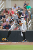 Cole Tucker (2) of the West Virginia Power squares to bunt against the Kannapolis Intimidators at Intimidators Stadium on July 3, 2015 in Kannapolis, North Carolina.  The Intimidators defeated the Power 3-0 in a game called in the bottom of the 7th inning due to rain.  (Brian Westerholt/Four Seam Images)