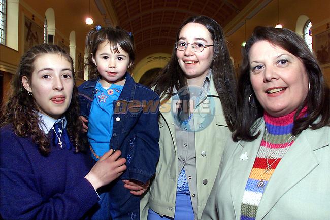Leanne McCartan,Moneymore, from Ballymakenny girls school who was confirmed at the Lourdes church, pictured with her sisters Kayleigh and Jenna and aunt Margret English..pic:Arthur Carron/ Newsfile