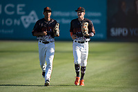 San Jose Giants outfielders Bryce Johnson (28) and Johneshwy Fargas (49) jog off the field between innings of a California League game against the Lancaster JetHawks at San Jose Municipal Stadium on May 12, 2018 in San Jose, California. Lancaster defeated San Jose 7-6. (Zachary Lucy/Four Seam Images)