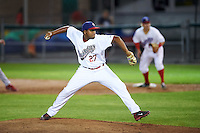 Auburn Doubledays relief pitcher Angher Cespedes (27) delivers a pitch during a game against the Williamsport Crosscutters on June 25, 2016 at Falcon Park in Auburn, New York.  Auburn defeated Williamsport 5-4.  (Mike Janes/Four Seam Images)