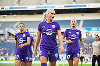 Orlando, Florida - Saturday, April 23, 2016: Alex Morgan (13), Kaylyn Kyle (6) and Dani Weatherholt (17) of the Orlando Pride warm up prior to an NWSL match between Orlando Pride and Houston Dash at the Orlando Citrus Bowl.