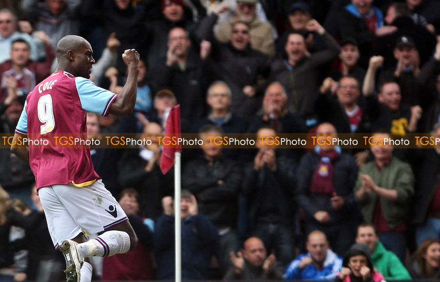 Carlton Cole celebrates after scoring the 1st goal for West Ham - West Ham United vs Reading, npower Championship at Upton Park, West Ham - 31/03/12 - MANDATORY CREDIT: Rob Newell/TGSPHOTO - Self billing applies where appropriate - 0845 094 6026 - contact@tgsphoto.co.uk - NO UNPAID USE..