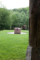 An Eduardo Chillida sculpture in the gardens of the historic Basque Zabalaga Farmhouse, once used as the working studio of now houses the permanent collection of the Chillida-Leku musum near San Sebasatian