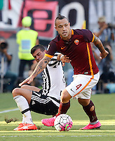 Calcio, Serie A: Roma vs Juventus. Roma, stadio Olimpico, 30 agosto 2015.<br /> Roma&rsquo;s Radja Nainggolan, right, is challenged by Juventus&rsquo; Stefano Sturaro during the Italian Serie A football match between Roma and Juventus at Rome's Olympic stadium, 30 August 2015.<br /> UPDATE IMAGES PRESS/Riccardo De Luca