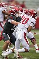Hawgs Illustrated/BEN GOFF <br /> John Stephen Jones, Arkansas quarterback, hands off to running back Jordon Curtis in the first quarter Saturday, April 6, 2019, during the Arkansas Red-White game at Reynolds Razorback Stadium.