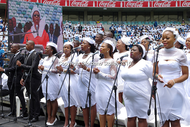 DURBAN - 4 December 2016 - A choir from the 4.5 million strong Twelve Apostles Church in Christ sing at a thanksgiving ceremony in Durban's Moses Mabhida Stadium. The ceremony was attended by the country's President Jacob Zuma as well as Durban's mayor Zandile Gumede, who can be seen in the big screen also singing. Professor Caesar Nongqunga the leader of the church later urged church members to deposit their savings into the same bank that had earlier in the year given Zuma a loan to repay the the government for controversial non-security upgrades to his personal residence in Nkandla. Picture: Allied Picture Press/APP