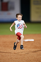 A kid runs the bases during a Mobile BayBears game against the Chattanooga Lookouts on May 5, 2018 at Hank Aaron Stadium in Mobile, Alabama.  Chattanooga defeated Mobile 11-5.  (Mike Janes/Four Seam Images)