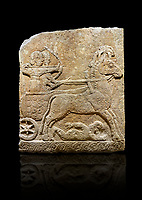 Hittite relief sculpted orthostat stone panel of Long Wall Limestone, Karkamıs, (Kargamıs), Carchemish (Karkemish), 900 - 700 B.C. Chariot. Anatolian Civilisations Museum, Ankara, Turkey<br /> <br /> One of the two figures in the chariot holds the horse's headstall while the other throws arrows. There is a naked enemy with an arrow in his hip lying face down under the horse's feet It is thought that this figure is depicted smaller than the other figures since it is an enemy soldier. The lower part of the orthostat is decorated with braiding motifs. . <br /> <br /> On a black background.