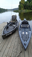 NWA Democrat-Gazette/FLIP PUTTHOFF <br /> The NuCanoe brand of fishing canoe is perfect    Sept. 24 2015     for small lakes like Lake Sequoyah, McBride said. His boat (left) is tricked out with a trolling motor, depth finder, livewell and more. The basic boat is at right.