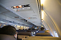 A view of airplane interiors with passengers