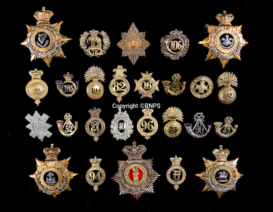 BNPS.co.uk (01202 558833)<br /> Pic: TomWren/BNPS<br /> <br /> A stunning collection of military badges amassed by one man has been unearthed to remember the lost regiments of the British Army.<br /> <br /> More than 800 brass badges recovered from old pith helmets, peaked caps and military tunics were amassed by the late collector over a lifetime.<br /> <br /> Many of the insignia date back to the Victorian era and represent regiments which no longer exist or which have been amalgamated, having either been decimated in the First World War or wiped out by government cuts.<br /> <br /> The collection is being sold by Charterhouse Auctioneers of Dorset.