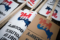 Details of signs at the Occupy New Hampshire and Occupy the Primary gathering in Veterans Memorial Park in Manchester, New Hampshire on Jan. 7, 2012.  The New Hampshire GOP presidential primary is on Jan. 10.