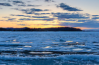 A golden Lake Superior sunset captured in the month of May and still ice as far as you can see out. Marquette, MI