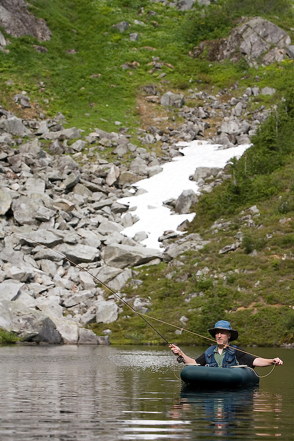 Photo by Stephen Brashear.Brian Curtis of Silverdale, Wash., a member of the Trailblazers, fishes Monogram Lake in the North Cascades National Park near Marblemount, Wash., Tuesday Aug. 12, 2008. The Trailblazers is a club of high lakes anglers that helps the U.S. Forest Service stock high mountain lakes.
