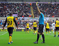 FAO SPORTS PICTURE DESK<br /> Pictured: David Hoilett of Blackburn Rovers (L) sees a yellow card from referee M Clattenburg (R) for his foul against Neil Taylor of Swansea. Saturday, 14 April 2012<br /> Re: Premier League football, Swansea City FC v Blackburn Rovers at the Liberty Stadium, south Wales.